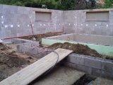 Süllyesztett víztükrű fólia burkolatú úszómedence építés